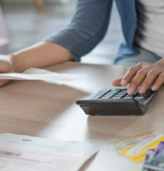 woman-hand-calculating-monthly-expense-credit-card-debt_42193-71